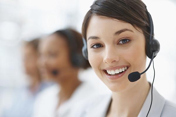 Closeup of a beautiful business customer service woman smiling